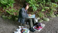 Old Senior Elderly Woman Artist Painter Painting In Tokyo Park Stock Footage