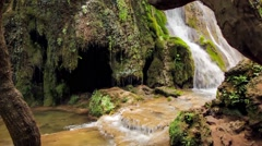 Waterfall in a forest of Bulgarian mountains. Slow motion Stock Footage