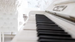Old white piano keyboard closeup video shooting. Cozy white interior - stock footage