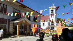 Kids santo nino parade in front of the Santo Nino de Anda Parish Church Stock Footage