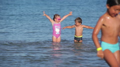 Children are falling back into the water - stock footage