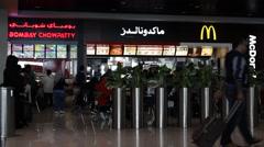 DUBAI, UAE - 3 FEBRUARY 2015: Mac Donalds. Dubai International Airport Stock Footage
