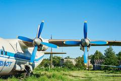 Turbines of turboprop old soviet aircraft An-12 at an abandoned aerodrome - stock photo
