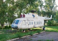 Old soviet helicopter MI-8 at an abandoned aerodrome - stock photo