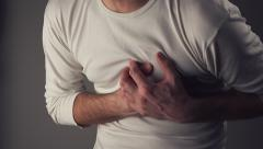 Man suffering from chest pain, having heart attack or cramps Stock Footage