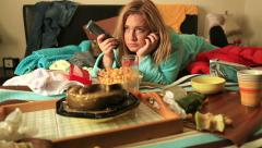 Depressive woman eating and waching tv 3 - stock footage