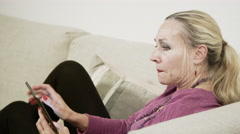 Grandmother using Tablet for Internet - Connected Middle Aged Baby Boomer - stock footage