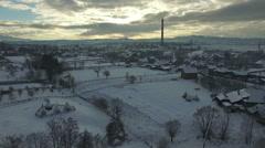 Winter scenery, flight above countryside village at sunset Arkistovideo