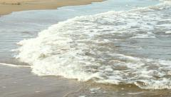 Foam waves on a sandy beach. Stock Footage