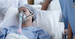 Female patient receiving artificial ventilation Arkistovideo
