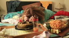 Depressive woman eating cake 2 - stock footage