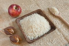 Uncooked Basmati rice in a wooden cup - stock photo
