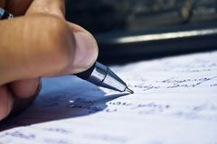 Young boy writing a paragraph - stock photo