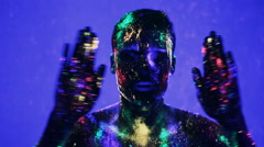 Guy dancing in the ultraviolet light Stock Footage