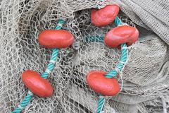 Used fishing net with floaters Stock Photos