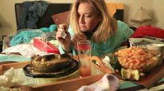Depressive woman eating cake - stock footage