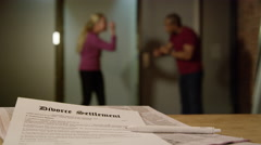 Angry couple arguing over divorce - Legal contract in foreground - stock footage