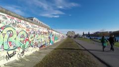 east side gallery, berlin wall, time lapse - people walking by - stock footage
