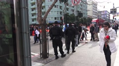 Busy San Francisco Street, Swat team armed Stock Footage