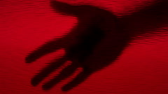 Red bloody hand silhouette smearing glass Stock Footage