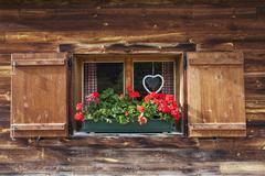 bavarian window with geranium - stock photo