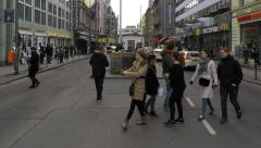 People taking pictures of border patrol police men - checkpoint charlie, berlin Stock Footage