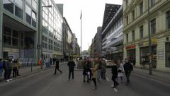 checkpoint charlie, berlin, germany - people taking pictures of border patrol po - stock footage
