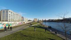 people at berlin wall, east side gallery time lapse -people walking - stock footage