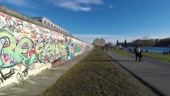 People at berlin wall, east side gallery - people walking by Stock Footage