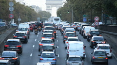 Traffic in Paris - Arc De Triomphe Du in the Background - Paris France - stock footage