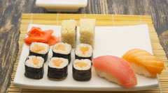 Tasty maki sushi put in a plate Stock Footage