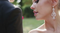 Stock Video Footage of The bride and groom are happy in the park summer. Emotional interaction
