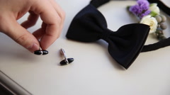 Close up of a groom takes his cufflinks Stock Footage