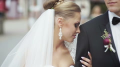 Happy cheerful couple, husband and wife, hugging in old european street Stock Footage
