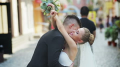 Handsome happy bride and beautiful sensual groom at romantic bridge in france Stock Footage