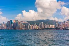 Sea front view with luxurious buildings in Hong Kong - stock photo