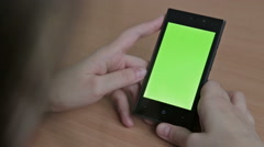Woman watch oh her cell phone, green screen Stock Footage