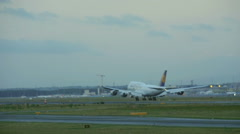 FanHansa Jumbo landing in Frankfurt, slow motion Stock Footage
