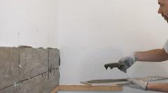 Home improvement, renovation - construction worker tiler is tiling, ceramic tile Stock Footage