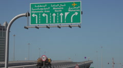 View of Al Fatih Highway and Motorway sign in Manama, Bahrain - stock footage