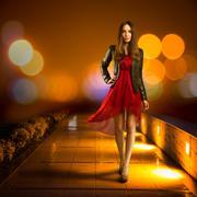 Woman in Red Dress Walking. Night City - stock photo