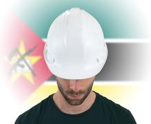 Engineer with flag on background - Mozambique - stock photo