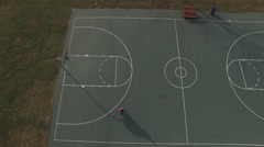 Boy missing shots on basketball court aerial view 4k Stock Footage