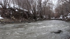 Water flow in city polluted river Stock Footage