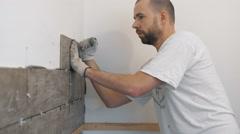 Home improvement, renovation - construction worker tiler is tiling, ceramic tile Arkistovideo