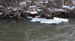 float garbage in city river - stock footage