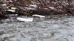Float garbage in city river Stock Footage