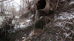 Water from rusty pipe pollute city river Stock Footage