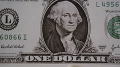Comparing Canadian Dollar to American Currency Stock Footage