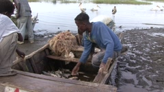 Fishermen with catch sitting in boat at Lake Awassa Stock Footage